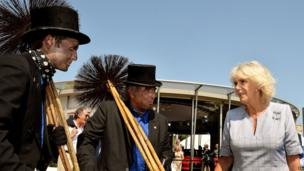 The Duchess of Cornwall talks to chimney sweeps Ben and Kevin Giddings