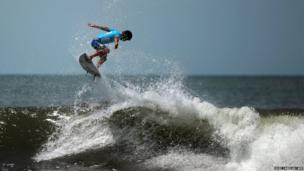 Conner Coffing from the US rides a wave