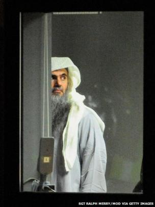 Abu Qatada prepares to board a plane at RAF Northolt