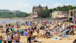 People pack the beach at Scarborough