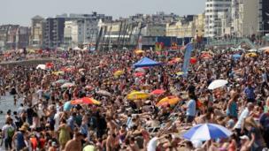 People on Brighton beach on 13 July 2012