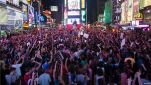 Protesters angered by George Zimmerman's acquittal fill Times Square in New York (14 July)