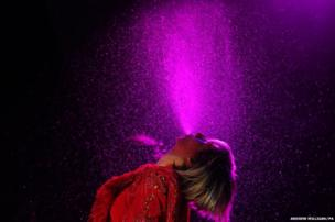 Karen O from the Yeah Yeah Yeahs sprays water