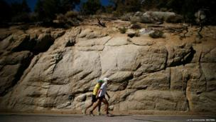 Carlos Alberto Gomes De Sa of Portugal walks with his pace setter on his way to winning the Badwater Ultramarathon at the foot of Mount Whitney, California