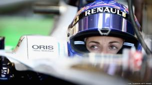 Susie Wolff, of Great Britain and Williams F1 team, prepares to drive during the young drivers test at Silverstone Circuit in Northampton, England.