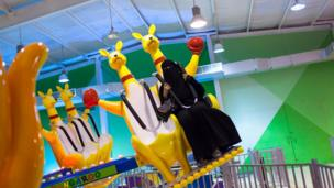 A woman wearing a burka on a carnival ride