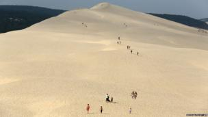 People walk on top of the dune of Pilat, the highest sand dune in Europe