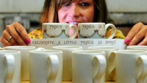 two memorabilia prototype mugs awaiting the Royal Baby to be named before going into production at Burleigh factory, Stoke On Trent.