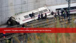 Rescue workers try to reach passengers trapped in the derailed train. 24 July 2013