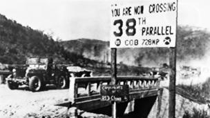 A jeep of the United Nations forces withdrawing from Pyongyang, the North Korean capital, crosses the 38th parallel in December 1950.