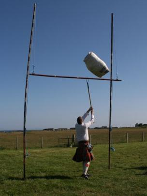 Man tossing the sheaf during Tiree Show