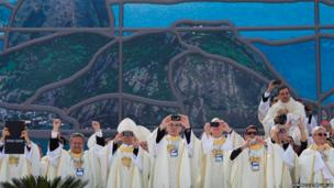 Roman Catholic clergy take photos