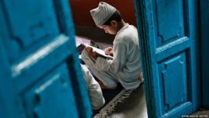 A Muslim boy learns to read the Koran