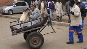 Chizema Majika, 80, in a pushcart in Zimbabwe on 31 July 2013