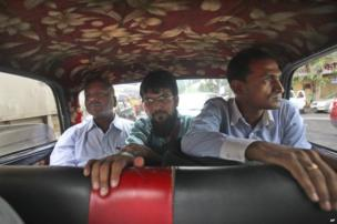people travel in a Mumbai Premier Padmini taxi, in Mumbai, India