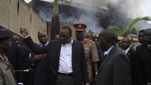 Kenya's President Uhuru Kenyatta visits the Jomo Kenyatta International Airport after a fire burnt a large section of the airport in Nairobi on 7 August 2013.