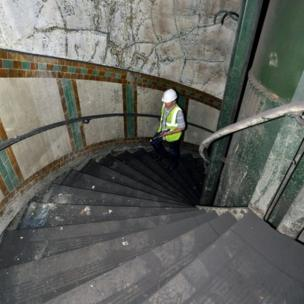 Ministry of Defence property surveyor Julian Chafer, ascends the spiral stairwell