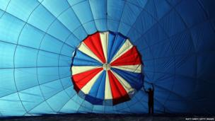 A balloon is inflated at the Bristol International Balloon Fiesta at the Ashton Court estate in Bristol, England