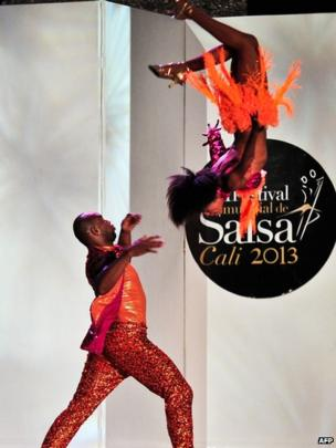 Colombian salsa dancers Juan Preciado (on the ground) and Leydi Rivas compete in the cabaret couples category during the VIII World Salsa Festival in Cali, Colombia (11 Aug 2013)