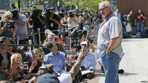 Steve Davis, brother of alleged James Bulger victim Debra Davis, speaks to media outside the federal courthouse in Boston on 12 August 2013.