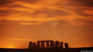 A general view of Stonehenge during the annual Perseid meteor shower in the night sky in Salisbury Plain, southern England on 13 August 13 2013. The Perseid meteor shower is sparked every August when the Earth passes through a stream of space debris left by comet Swift-Tuttle. Picture taken using a long exposure.