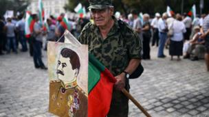 Bulgarian Socialist Party supporter with a portrait of Joseph Stalin, in Sophia, Bulgaria - Friday 16 August 2013