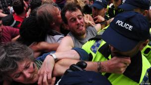 Police tussling with several protesters