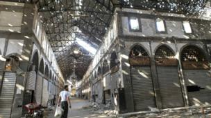A man walks inside the damaged historic old souk of Homs August 19, 2013. Picture taken August 19, 2013.