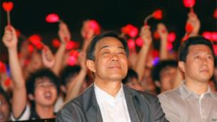 This picture taken on May 2, 2010 shows the then Chongqing mayor Bo Xilai (C) attending an event at a college in Chongqing. China