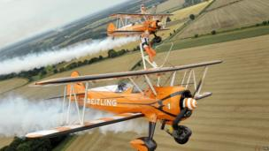 Nine-year-old cousins Rose (front) and Flame wingwalking over Rendcomb Airfield near Cirencester for the charity Duchenne Children's Trust, becoming the world's youngest formation wingwalkers.