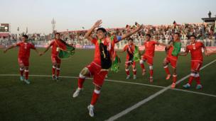 Afghan footballers celebrate their 3-0 win against Pakistan