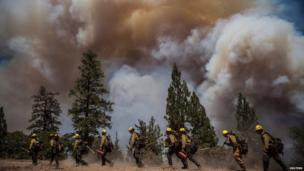 Los Angeles County firefighters hike in on a fire line on the Rim Fire near Groveland, California, 22 August, 2013.