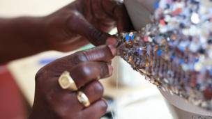 Close-up of woman sewing sequins