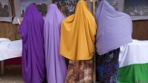 Girls at the book fair viewing a photo exhibition by Ethiopia-based photojournalist Petterik Wiggers - Hargeisa, Somaliland
