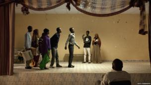 Actors rehearsing for a play addressing the theme of corruption, which was performed during the closing ceremony of the book fair, in front of a diverse crowd of guests including government ministers and elders - Hargeisa, Somaliland