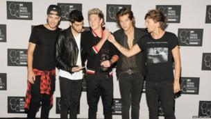 One Direction boys pose for a photograph