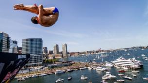 Diver Michal Navratil diving from a 27.5 metre platform in Boston