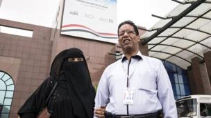 Ahmed Ateeq, a professor at Sanaa University and a member of Yemen's National Dialogue Conference, is guided by his wife Masouda.
