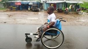 A man in a wheelchair takes part in a race in Monrovia, Liberia, on 25 August