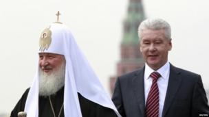Moscow mayor Sergei Sobyanin (right) walks with Kirill, Patriarch of Moscow and all Russia