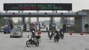 New Zealanders motorcyclists arrive at the CIQ (Customs, Immigration and Quarantine) office, just south of the demilitarized zone (DMZ) separating the two Koreas, in Paju, north of Seoul
