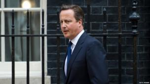 British Prime Minister David Cameron leaves Downing Street on 29 August, 2013