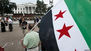 Demonstrators calling for help from US President Obama for the Syrian opposition protest in front of the White House late 21 August, 2013, in Washington