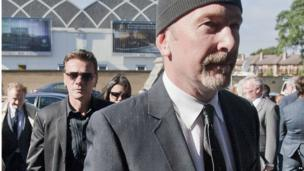 U2's The Edge and fellow band member Larry Mullen Jr accompanied lead singer Bono to the funeral.