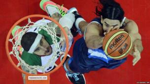 Argentine Luis Scola tries to score against Mexican Lorenzo Mata