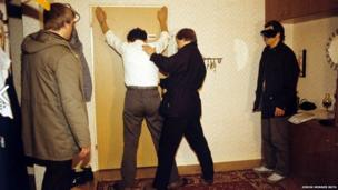 A staged Stasi arrest for training purposes