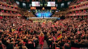 People wave flags at the Royal Albert Hall in west London on September 7, 2013 during the last night of the Proms
