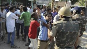In this photo, people argue with Indian policemen during curfew hours following riots and clashes between two communities in Muzaffarnagar in the Indian state of Uttar Pradesh.