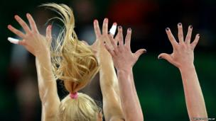 Russia's Iuliia Morozova and Ekaterina Pankova jump to block the ball during the Women's Volleyball European Championship