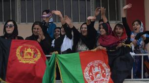 Female Afghan football fans celebrate their national football team's victory in the South Asian Football Federation Championship, at the Kabul stadium on 12 September 2013.
